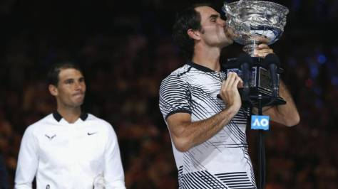 _93858796_rogerfedererkissesthetrophy_reuters.jpg